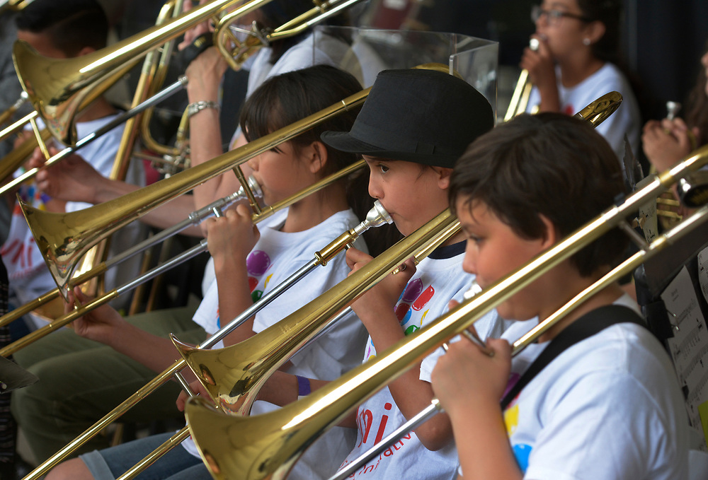 gbs051417d/ASEC -- Elia Pizarro, 9, center is flanked by Maryann Jacobson, 11, left, and Arriana Chavez, 11, right as the Young Musician's Initiative perform during Mother's Day at the ABQBioPark on Sunday, May 14, 2017. (Greg Sorber/Albuquerque Journal)