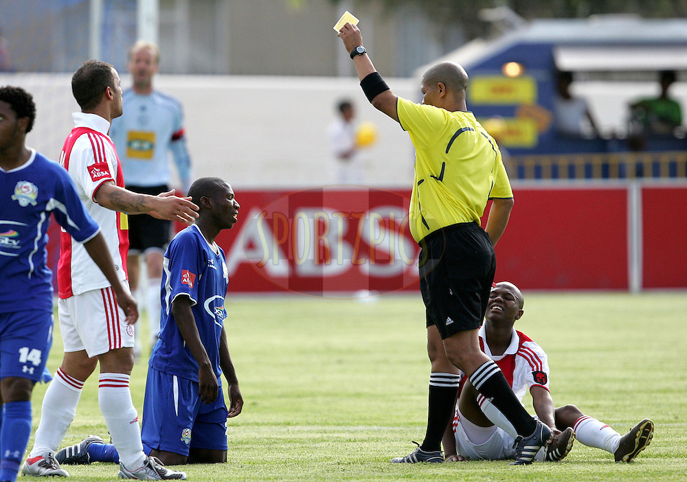 Jabu Maluleke gets a yellow card from referee Jacob Frolick during the Absa Premiership , PSL, match between Ajax Cape Town and Supersport United held at the Boland Stadium in Wellington, South Africa on the 1st december 2009..Photo by: sportzpics.net