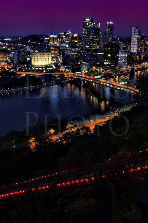 Pittsburgh at night with the red Incline lights in the foreground, with the Fort Pitt Bridge going over the Monongahela River and the Parkway glowing orange. Taken from the West End Overlook, and in my opinion, this city is one of the most beautiful in the darkness.