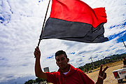 "10 JANUARY 2007 - MANAGUA, NICARAGUA: A Sandanista supporter waves the red and black Sandanista banner in Managua. Daniel Ortega, the leader of the Sandanista Front, was sworn in as the President of Nicaragua Wednesday. Ortega and the Sandanistas ruled Nicaragua from their victory of ""Tacho"" Somoza in 1979 until their defeat by Violetta Chamorro in the 1990 election.  Photo by Jack Kurtz"
