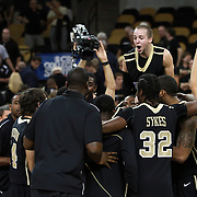 Central Florida guard A.J. Rompza (3) screams with the UCF Knights players after winning the NCAA basketball game against the USF Bulls at the UCF Arena on November 18, 2010 in Orlando, Florida. UCF won the game 65-59. (AP Photo/Alex Menendez)