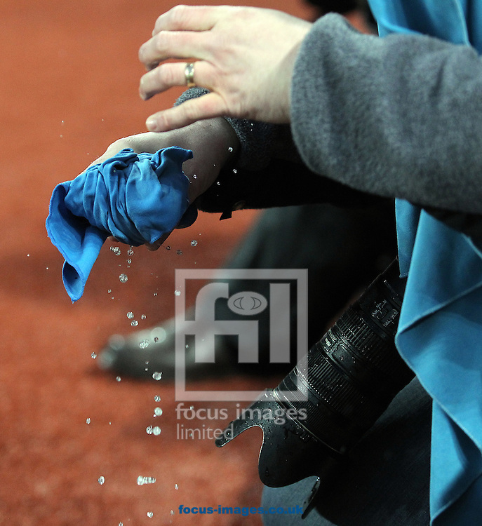 Photographer's struggle to keep their equipment dry in very wet conditions during the Barclays Premier League match at Villa Park, Birmingham<br /> Picture by Paul Chesterton/Focus Images Ltd +44 7904 640267<br /> 06/02/2016