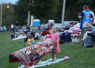 Hope Siems, 5, of Cedar Rapids spreads out her blanked before the start of the Cedar Boat Club Venetian Nights Lighted Boat Parade and Fireworks along the Cedar River on Saturday evening, August 18, 2012.