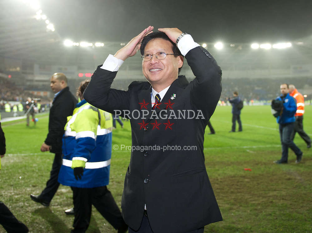 CARDIFF, WALES - Tuesday, January 24, 2012: Cardiff City's owner Dato Chan Tien Ghee celebrates his side's penalty shoot-out victory over Crystal Palace during the Football League Cup Semi-Final 2nd Leg at the Cardiff City Stadium. (Pic by David Rawcliffe/Propaganda)