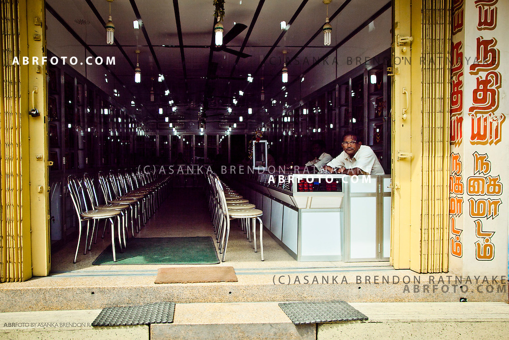 jewellery merchant awaiting customers at his jewellery boutique.