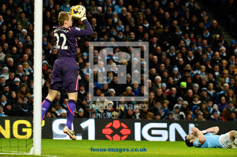 Picture by Ian Wadkins/Focus Images Ltd +44 7877 568959<br /> 26/12/2013<br /> Simon Mignolet of Liverpool claims the ball as &Aacute;lvaro Negredo of Manchester City lies injured during the Barclays Premier League match at the Etihad Stadium, Manchester.