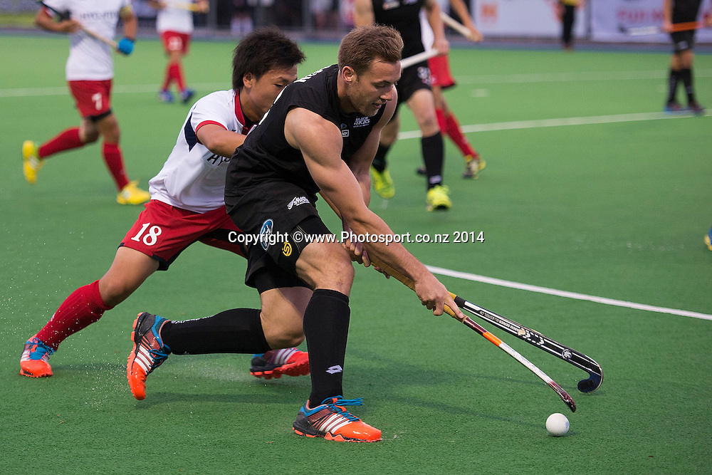 Richard Bain (Front) of New Zealand is tackled by Hirotaka Zendana of Japan during the Black Sticks Men v Japan international hockey match at the Coastlands Kapiti Sports Turf in Paraparaumu on Friday the 21st of November 2014. Photo by Marty Melville/www.Photosport.co.nz