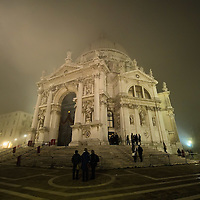 VENICE, ITALY - NOVEMBER 20:  The church of Santa Maria della Salute is seen as thick fog shrouds the city, on November 20, 2011 in Venice, Italy. Venice woke up this morning under a heavy blanket of fog adding to the atmosphere of the city. <br /> <br /> HOW TO LICENCE THIS PICTURE: please contact us via e-mail at sales@xianpix.com or call our offices London   +44 (0)207 1939846 for prices and terms of copyright. First Use Only ,Editorial Use Only, All repros payable, No Archiving.© MARCO SECCHI