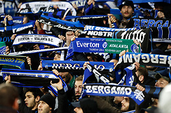 Atalanta fans in the stands show their support with half and half scarves