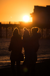 © Licensed to London News Pictures. 27/12/2017. Southsea, UK.  People watching the the sun set over Southsea pier this afternoon. Clearing skies will cause the temperatures drop overnight. Photo credit: Rob Arnold/LNP