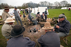 © London News Pictures. 08/04/2012. South Okendon, UK.  Members of the Southern Skirmish Association dressed as Confederate soldiers relax at camp before taking part in a reenactment of the final days of the American Cival war at Belhus Wood Country Park near South Okenden, Essex on April 8, 2012. The American Civil war was ended on April 9 (Tomorrow), 1865 when the  Confederate surrendered to the Union. Photo credit :  Ben Cawthra/LNP
