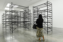 "© Licensed to London News Pictures. 11/09/2019. LONDON, UK. A visitor views ""Quarters"", 2017. Preview of ""Remains to be Seen"", a new exhibition by Mona Hatoum at White Cube gallery in Bermondsey.  This is the first presentation of her work since Tate Modern in 2016.  The show runs 12 September to 3 November 2019.  Photo credit: Stephen Chung/LNP"
