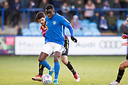 Macclesfield Town forward Arthur Gnahoua tackled by the opponent during the EFL Sky Bet League 2 match between Macclesfield Town and Bradford City at Moss Rose, Macclesfield, United Kingdom on 30 November 2019.