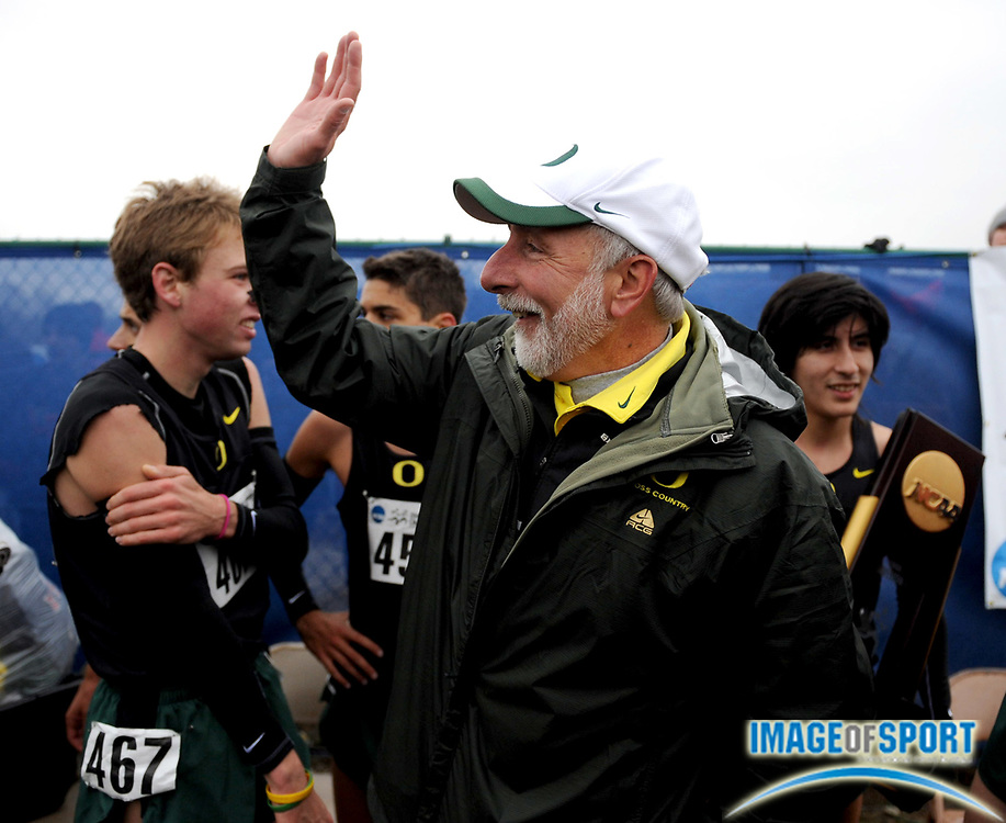 Nov 24, 2008; Terre Haute, IN, USA; Oregon coach Vin Lananna congratulates runners after the Ducks won the team title in the NCAA cross country championships at the LaVern Gibson cross country course.