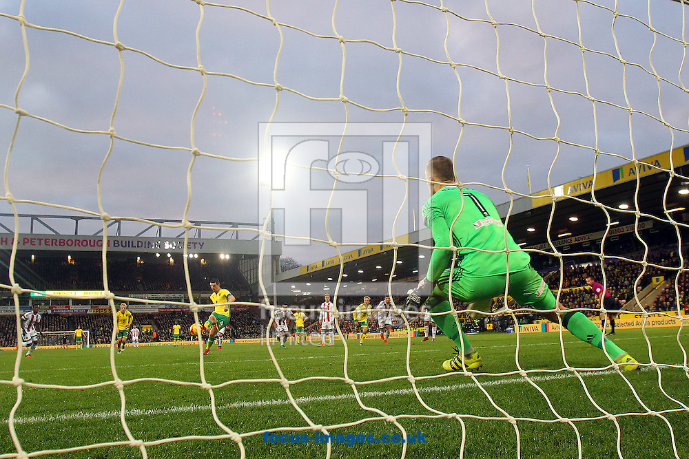 Graham Dorrans of Norwich sees his penalty saved by Daniel Bentley of Brentford but is first to react to score his side's 2 second goal from the rebound during the Sky Bet Championship match at Carrow Road, Norwich<br /> Picture by Paul Chesterton/Focus Images Ltd +44 7904 640267<br /> 03/12/2016