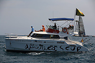 America's Cup officials' boat sits at edge of race course prior to start of fleet racing; Valencia, Spain.