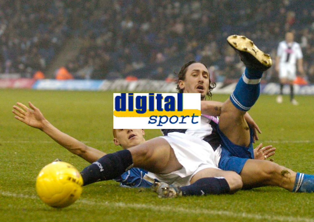 Photo: Glyn Thomas.<br />West Bromwich Albion v Reading. The FA Cup. 07/01/2006.<br />West Brom's Jonathan Greening (R) is brought down by Steve Sidwell (L) but no foul is awarded.