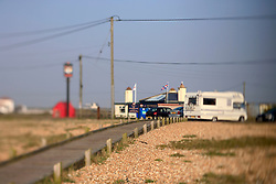UK ENGLAND DUNGENESS 24MAR12 - A camper van and wooden walkway to the shore at Dungeness shingle beach on the Kent coast. It is the  largest area of open shingle in Europe, measuring 12 km by 6 km, which has been deposited by the sea and built up over thousands of years.....jre/Photo by Jiri Rezac....© Jiri Rezac 2012