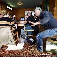 Nederland, Amsterdam , 13 oktober 2011..Foto in 1 van de hotelkamers van hotel Lloyd tijdens Workshop Art Department and Waste  in het kader van Green Film making ..Op de foto spreker Rob Bos van Eko Bouwmarkt neemt plaats op zijn eco toilet tijdens de workshop..Foto:Jean-Pierre Jans