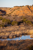 FLY ANGLER FISHING A RIVER IN FAR WEST TEXAS PEASE RIVER TEXAS