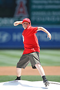 ANAHEIM, CA - MAY 06:  Little League member Darren Faris throws out the celebratory first pitch before the Los Angeles Angels of Anaheim game against the Toronto Blue Jays on Sunday, May 6, 2012 at Angel Stadium in Anaheim, California. The Angels won the game 4-3. (Photo by Paul Spinelli/MLB Photos via Getty Images) *** Local Caption *** Darren Faris