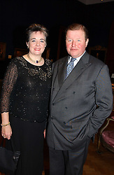 MR EDWARD & LADY JANE DAWNAY at a reception hosted by Brian Ivory Chairman of the Trustees of The National Galleries of Scotland to commemorate Sir Timothy Clifford's 21 years of Director of the National Gallery of Scotland and his forthcoming retirement in January 2006, held at Christie's, King Street, London W1 on 6th December 2005.<br />