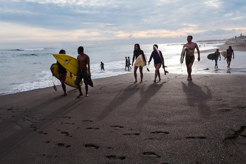 Surfers at Batubolong beach in Canggu.