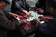 Morning game of Mah Jongg in Dali, Yunnan, China; September, 2013. Many older people once retired have little to do during their days.