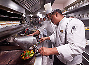 India, Rajasthan. Maharajas' Express luxury train. Head chef Tony Stone in the kitchen galley.