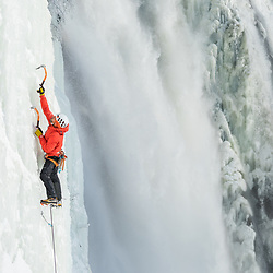 Jeff Mercier climbing Piler Direct at Montmorency Falls in Quebec City, Quebec, Canada