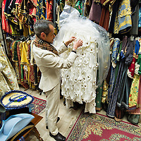 VENICE, ITALY - JANUARY 20:  Choreographer Raffaele Dessi of the historic atelier Pietro Longi examines an Elizabeth I costume on January 20, 2012 in Venice, Italy. This is one of the busiest periods of the year for the atelier as the next few weeks the streets and canals of Venice will be filled with people attending the carnival, wearing highly-decorative and imaginative carnival costumes and masks.