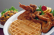 Twiams Chicken and Waffles family restaurant at 2517 Dixie Highway: The Number Three Special - Four deep fried whole jumbo chicken wings and one Twiams Belgian waffle, with a deep fried potato.