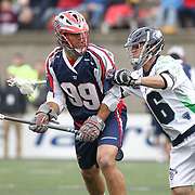 Paul Rabil #99 of the Boston Cannons keeps the ball away from Jesse Bernhardt #36 of the Chesapeake Bayhawks during the game at Harvard Stadium on April 27, 2014 in Boston, Massachusetts. (Photo by Elan Kawesch)