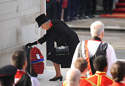 Queen Elizabeth II lays a wreath during the annual Remembrance Sunday Service at the Cenotaph memorial in Whitehall, central London, held in tribute for members of the armed forces who have died in major conflicts.