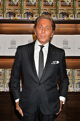 Designer VALENTINO GARAVANI at a party to celebrate the launch of the Maison Assouline Flagship Store at 196a Piccadilly, London on 28th October 2014.  During the evening Valentino signed copies of his new book - At The Emperor's Table.