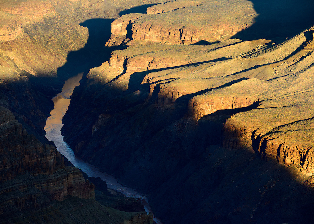 The Colorado River waits for sunlight to reach the shadowy depths of the Grand Canyon.
