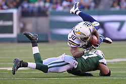 Dec 23, 2012; East Rutherford, NJ, USA; San Diego Chargers running back Ronnie Brown (30) is tackled by New York Jets safety Yeremiah Bell (37) during the first half at MetLIfe Stadium.