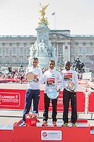IPC Marathon World Cup - Men's T44-T46 event winner Ito Sena of Brazil (centre) with runner-up Alessandro Di Lello of Italy (left) and third place athlete Ezequiel Da Costa of Brazil (right) on the podium at the Virgin Money London Marathon 2014 at the finish line on Sunday 13 April 2014<br />