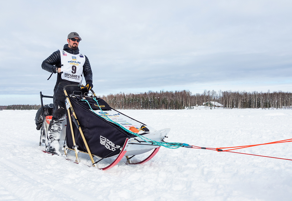 Musher Peter Kaiser after the restart in Willow of the 47th Iditarod Trail Sled Dog Race in Southcentral Alaska.  Afternoon. Winter.