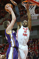 05 January 2013:  Jackie Carmichael stands between Seth Tuttle and the goal during an NCAA Missouri Valley Conference (MVC) mens basketball game between the Northern Iowa Panthers and the Illinois State Redbirds in Redbird Arena, Normal IL
