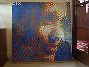 10/08/2010 - London - EXCLUSIVE -<br /> <br /> Icons Made from Rubik Cubes<br /> <br /> CIX is a Modern Contempory artist inspired by the works of French artist Invader. Rubik Cubes possess the same qualities in bulk, as digital picturesdo, they are both made up from tiny square colouredpixels, so there is a natural symmetry. Artist David Hyde's early pieces using large cubes on custom made wooden framesweigh around 15kg, however the smaller cubes on the Perspex frames weigh approximately 3kg. What is the average time taken to complete a piece, from start to finish ? That depends. It can sometimes take me a couple of days to get my template right. When I was commissioned to do a Michael Jackson piece for a fan, it took me about 20 hours and I tried over 50 different images just to create the template. Once a template is in place I can generally complete the piece in a couple of days or between 20-30 hours. I currently use custom made Perspex frames, which are made to orderonce I have completed my template. These have a built in shelf at the bottom for support, and allow you to see the back of the pieceas well. I use a clear silicone adhesive to attach each cube toeach other and to the Perspex frame. This creates an almost invisible glue which is very strong when it has set and allows thepiece to be seen from behind as well which adds to the ambiance. <br /> Photo Shows: Angelina Jolie<br /> (©David Hyde/Exclusivepix)