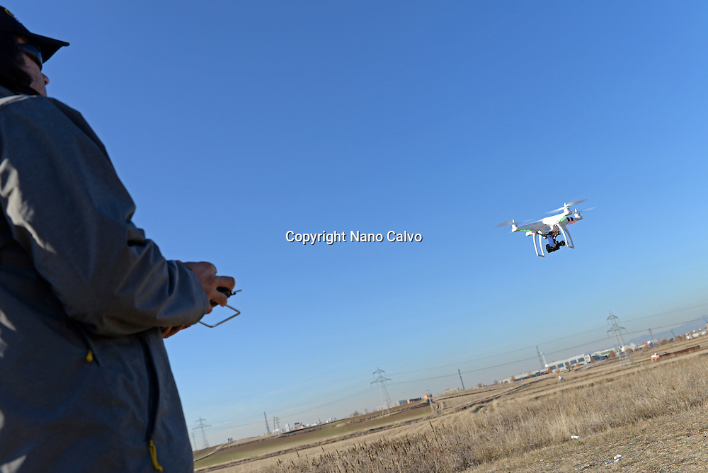 Young man flying Phantom Drone outdoors