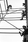 Crew climbing scaffolding, Glastonbury, Somerset, 1989