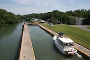 A boat passes through lock 3 of the Cayuga-Seneca Canal in Seneca Falls on Wednesday, July 29, 2015.