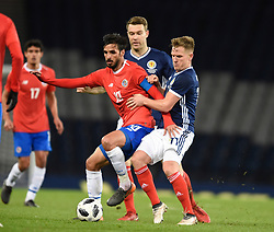 Costa Rica's Bryan Ruiz with Scotland's Kevin McDonald and Scotland's Matt Ritchie during the international friendly match at Hampden Park, Glasgow.RESTRICTIONS: Use subject to restrictions. Editorial use only. Commercial use only with prior written consent of the Scottish FA.