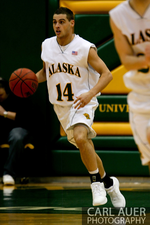 1/13/2006: Junior guard Luke Cooper (14) of the UAA Seawolves brings the ball up court as Alaska Anchorage gets a comeback victory over Northwest Nazarene, 60-57, in men?s basketball action at the Wells Fargo Sports Complex on Saturday.