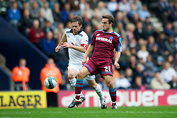PRESTON, ENGLAND - Saturday, September 24, 2011: Tranmere Rovers' new boy Jose Baxter and Preston North End's Graham Alexander during the Football League One match at Deepdale. (Pic by Dave Kendall/Propaganda)