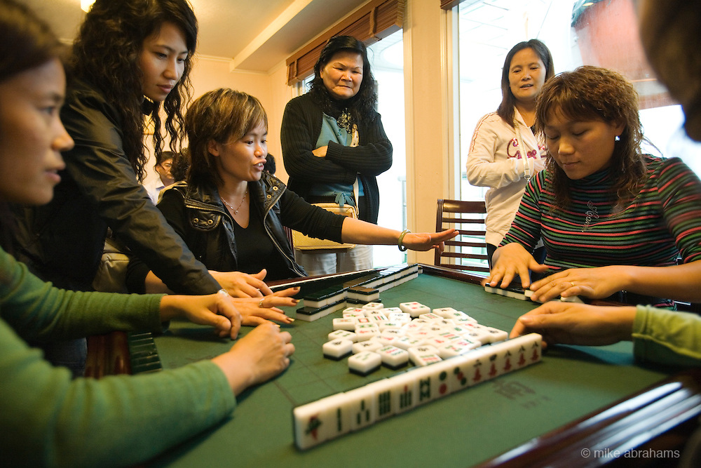 Playing mahjong on a cruise ship travelling up the Yangtze river, The People's Republic of China