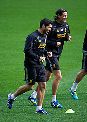 MELBOURNE, AUSTRALIA - Monday, July 22, 2013: Liverpool's Luis Suarez and Martin Kelly during a training session at Aami Park ahead of their preseason friendly against Melbourne Victory. (Pic by David Rawcliffe/Propaganda)