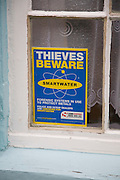 Thieves Beware Smartwater forensic system against scrap metal theft notice in window